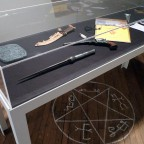 Vitrine with Demon Ward, 2014.  Artists' props featured (counterclockwise) Colt & Angel Blade by Oz DeShaw, Angel Tablet by Beth Heinly, First Blade by Scott Wheelis