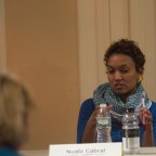 The panelists involved in a discussion, Nuala Cabral pictured.