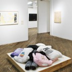 Installation view: Feminist Body Pillow (2013), Hand printed t-shirts, jeans; Untitled (Diagram of Influences), a personal document of projet MOBILIVRE BOOKMOBILE project (2001-2006) drawing, color photographs; By Ginger Brooks Takahashi and courtesy of the artist. Image courtesy of Vox Populi.