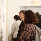 Visitors looking at the work of Miranda July during the opening night of the Alien She exhibition.