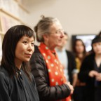 Astria Suparak, co-curator of Alien She, listening to her introduction during the opening night of the Alien She exhibition.