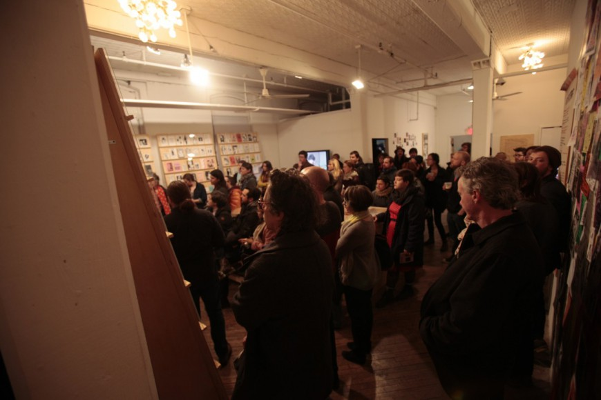 The audience listens to Astria Suparak, Co-Curator of Alien She, during her gallery talk on the opening night of the Alien She exhibition.