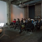 Lauren Cook presents her work to the audience at Full Circle