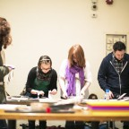 Zine Workshop participants creating original artwork and zines from magazines, paper ephemera, an on-site photocopier and other collected materials