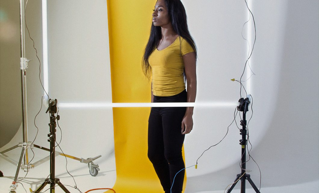 Christie Neptune, Woman Standing in Spotlight, 2016